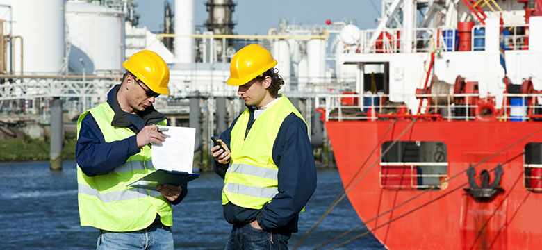 Two maritime workers discussing job specifics