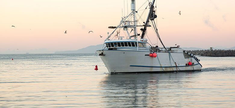 Working on a commercial boat like this one can cause commercial fishing injuries, so it's best to be aware of ways to prevent these injuries from occurring.