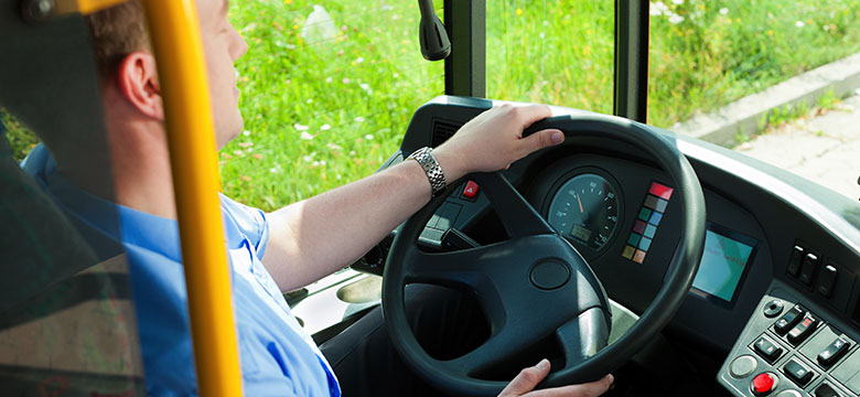 Man Driving a School Bus